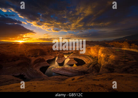 Sun's rays shining through clouds over Reflection Canyon Lake Powelll Utah USA Landscapes - Stock Photo