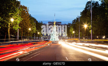 The Mall Victoria Monument and Buckingham Palace at Night London UK - Stock Photo