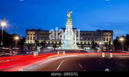 Victoria Monument and Buckingham Palace At Night London UK - Stock Photo