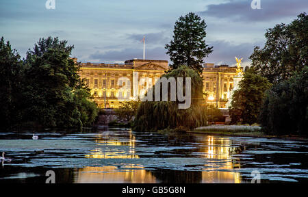 Buckingham Palace At night with Pond In St James Park London UK - Stock Photo