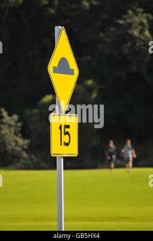 Yellow Bump Street Sign - Stock Photo