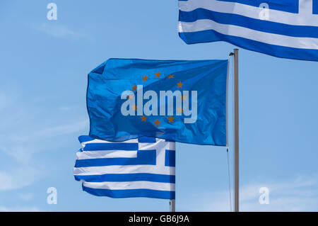 The European flag flying with Greek flags, Kefalos, Kos (Cos), The Dodecanese, South Aegean Region, Greece - Stock Photo