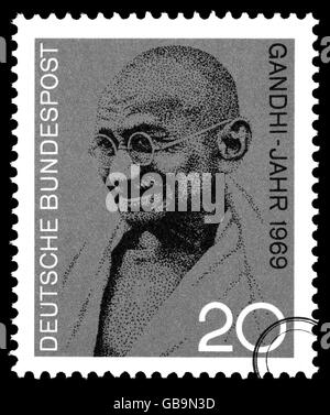 A postage stamp printed in Germany depicting a portrait of Mohandas Karamchand Gandhi, circa 2004 - Stock Photo