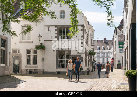 Couple walking through Maastricht old town, Holland, Europe - Stock Photo