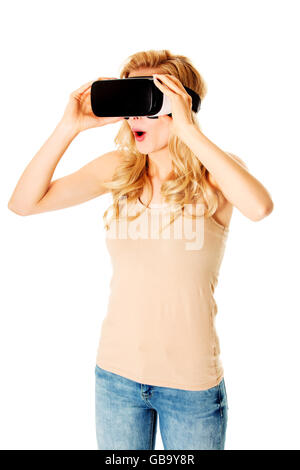 Happy woman wearing virtual reality goggles - Stock Photo