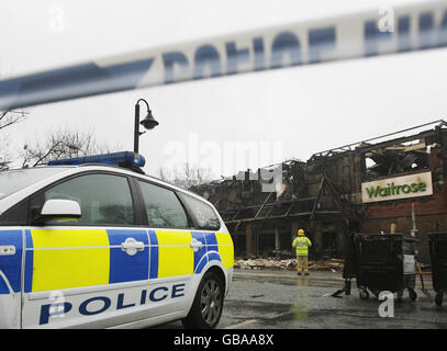 Fire destroys Waitrose store in Surrey - Stock Photo