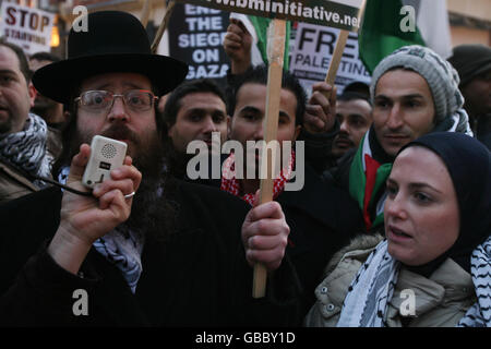 Palestinian protest against Israeli air strikes - Stock Photo