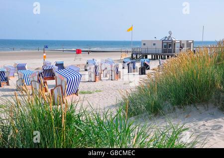 Sommer, Urlaub, Strand, Duenen, Nordsee, Strandkoerbe, Ostfriesland, Wattenmeer, Norderney, Seebad, Niedersachsen, - Stock Photo