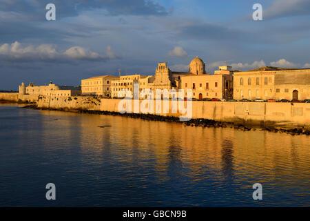 Sunrise Ortygia seafront, Syracuse, Sicily, Italy - Stock Photo