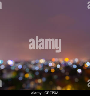 Out of focus city lights at night background - Stock Photo