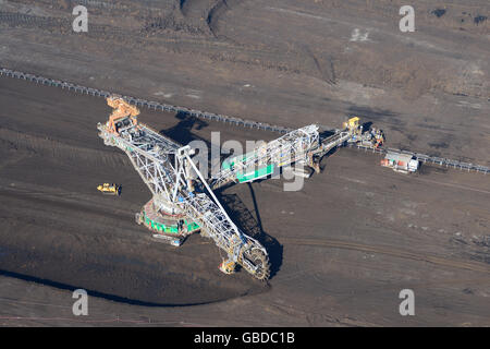 BUCKET-WHEEL EXCAVATOR IN AN OPEN-PIT COAL MINE (aerial view). Near Belchatow in Poland. - Stock Photo