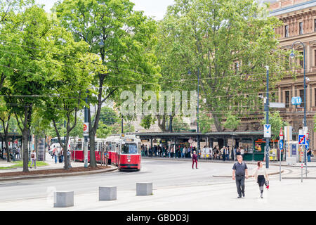 Tram and people on Burgring Ringstrasse in inner city of Vienna, Austria - Stock Photo