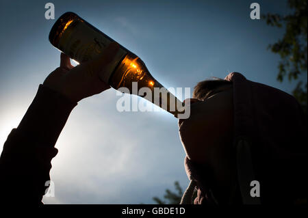 Teenager drinking beer. - Stock Photo