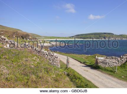 A single track road leading to a beach near Port Ellen on the Isle of Islay, Inner Hebrides, Scotland. - Stock Photo
