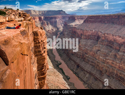 Two young men looking at Grand Canyon from Toroweap Point at North Rim, 1000 meters above Colorado River, Arizona, - Stock Photo