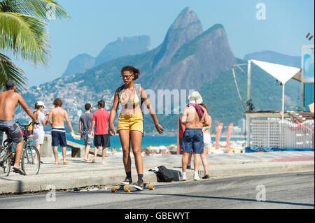 RIO DE JANEIRO - FEBRUARY 28, 2016: Young carioca Brazilian woman skates on the beachside bike path in Ipanema Beach. - Stock Photo