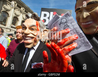 Protestors wearing Tony Blair and George Bush masks with bloody hands as Sir John Chilcot delivers the findings - Stock Photo