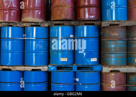 Colorful stacks of oil drums - Stock Photo