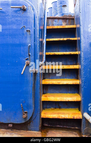 Yellow steps on a blue boat - Stock Photo