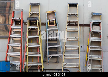 Ladders hanging on a wall - Stock Photo
