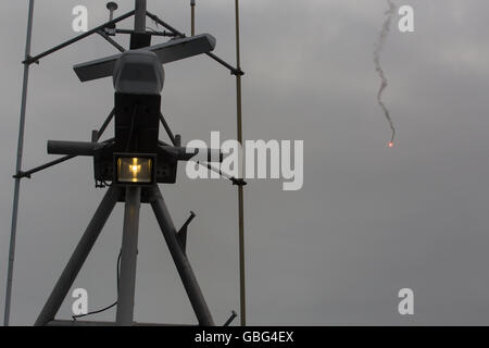ship signal flare with communication tower - Stock Photo