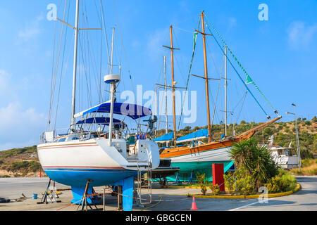 Sailing boats in shipyard of small Greek marina, Samos island, Greece - Stock Photo