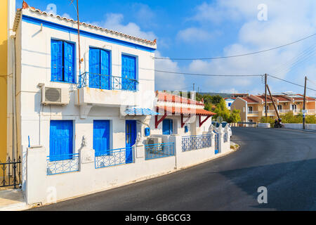 Typical Greek style houses on street of Pythagorion town, Samos island, Greece - Stock Photo