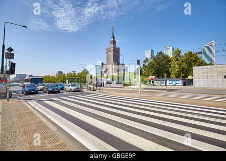 Warsaw, Poland - 26 June 2016: Pedestrian crossing in front of the Palace of Culture and Science, best known city - Stock Photo