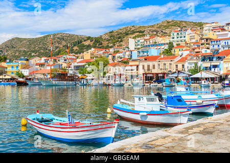 Traditional colourful Greek fishing boats in Pythagorion port, Samos island, Greece - Stock Photo
