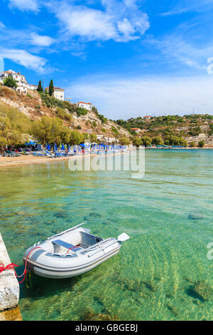 Dinghy boat on turquoise sea water at Pythagorion beach, Samos island, Greece - Stock Photo