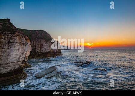 sunset at  Flamborough Head, showing chalk stack and cliffs overlooking north sea in summer, Yorkshire, United Kingdom - Stock Photo