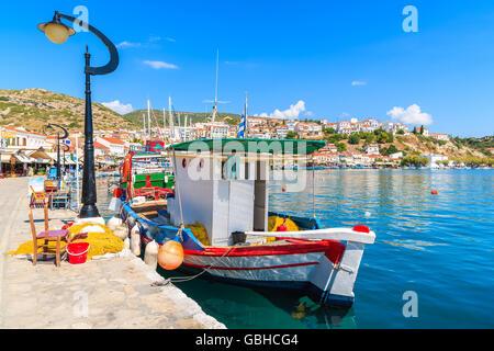 SAMOS ISLAND, GREECE - SEP 25, 2015: Greek fishing boat mooring in Pythagorion port, Samos island, Greece. - Stock Photo