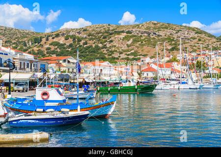 SAMOS ISLAND, GREECE - SEP 25, 2015: view of Pythagorion port with colourful fishing boats, Samos island, Greece - Stock Photo
