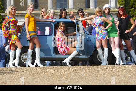 Models in mini-dresses with an early Morris Mini at Goodwood House near Chichester, West Sussex where Lord March announced the line-up for the 2009 Festival of Speed which will celebrate the 50th anniversary of the British classic.