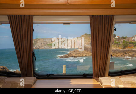 View from a caravan window of the sea and cliffs in Comillas Cantabria Northern Spain - Stock Photo