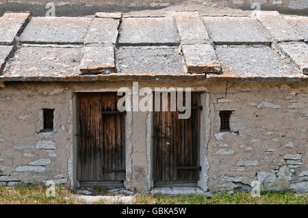 Rustic mountain building used as a stable for the herd and home to the shepherds during the summer grazing, Malga - Stock Photo