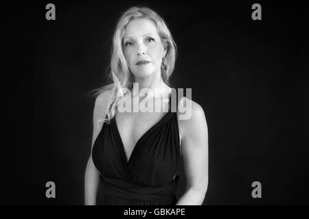 Black and white portrait of blond woman. - Stock Photo