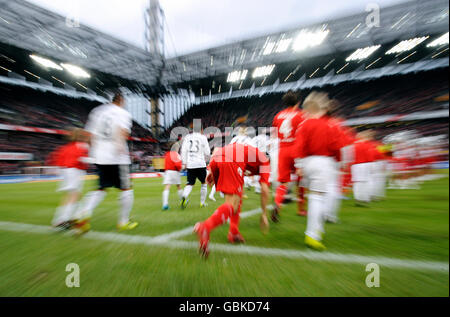 Teams entering the field, 1. FC Koeln - FC Bavaria Munich 3:2, Bundesliga, Federal League, 2010-2011 season, 21st - Stock Photo