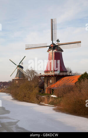 Twin Dutch windmills, Greetsiel, Krummhoern, East Frisia, Lower Saxony, North Sea - Stock Photo