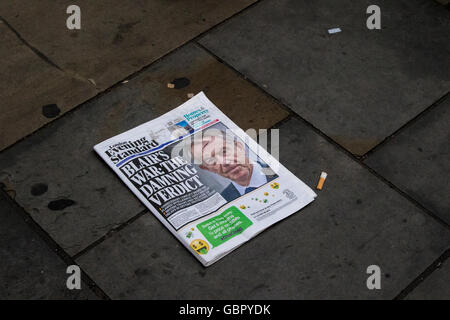 London, UK. 6th July, 2016. An evening newspaper lies discarded in the street. Former Prime Minister Tony Blair - Stock Photo