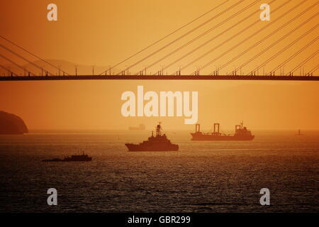 Vladivostok, Russia. 7th June, 2016. A view of a bridge over the Zolotoy Rog [Golden Horn] Bay from the lighthouse - Stock Photo