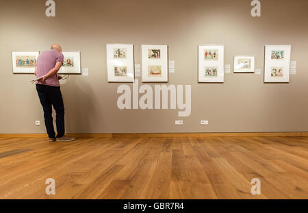 Hanover, Germany. 8th July, 2016. A man looking at 19th century caricatures, during a press conference on the opening - Stock Photo