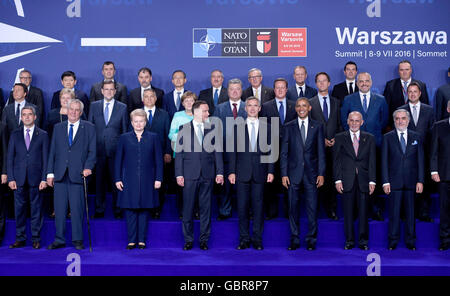 Warsaw, Poland. 8th July, 2016. The heads of states and governments of the Nato gathered for a group photo before their first meeting at the national stadium in Warsaw, Poland, 8 July 2016. PHOTO: RAINER JENSEN/dpa/Alamy Live News Stock Photo