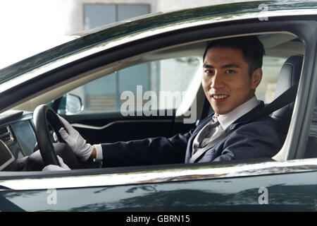 The young man is driving - Stock Photo