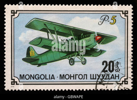 Stamp printed in Mongolia shows biplane P-5, series, circa 1976 - Stock Photo