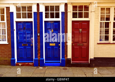 Colourful Doors to Nos 19, 19A & 21 High Street Bridlington Old Town - Stock Photo