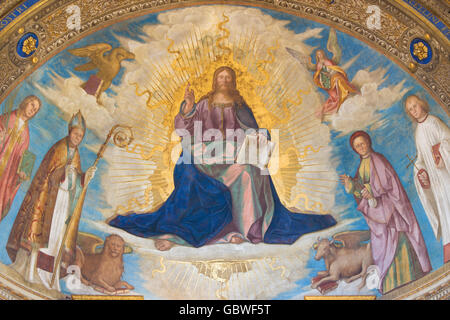 CREMONA, ITALY, 2016: Fresco of  Redeemer with Cremona's Patron Saints in Cathedral of Assumption of the Blessed - Stock Photo