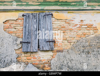 Closed Window on the Dilapidated Facade of the Old Italian House. Vintage effect. - Stock Photo