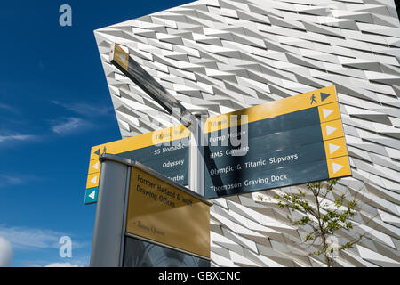 Close up of tourist sign posts at Titanic Belfast visitor centre, Northern Ireland - Stock Photo