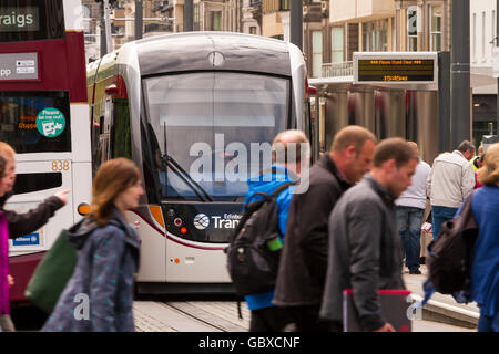 Tram arrives at platform, Princes Street, Edinburgh, Scotland - Stock Photo